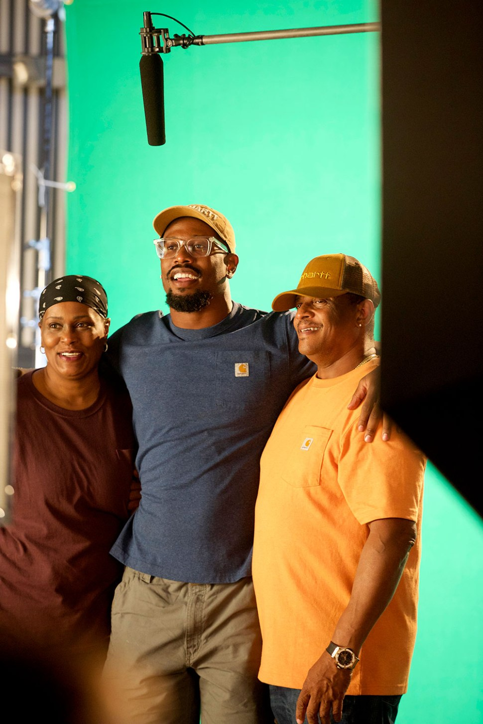 Von Miller with his parents on the set of a Carhartt commercial